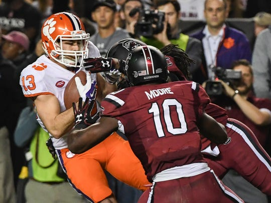 Clemson wide receiver Hunter Renfrow (13) scores near South Carolina defender Skai Moore(10) during the second quarter in Williams-Brice Stadium in Columbia on Saturday.