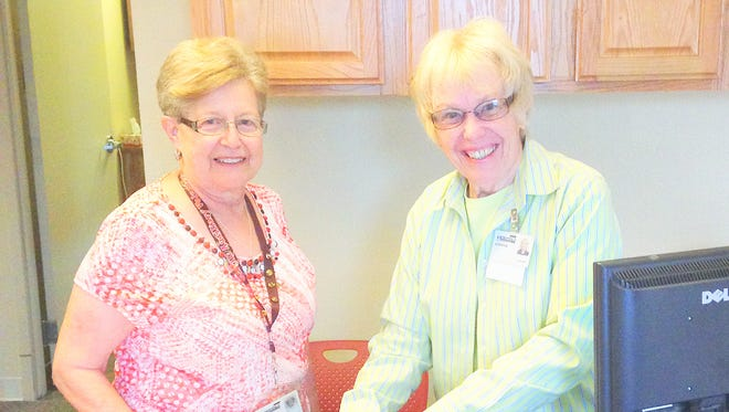 From left, are Gloria Lopez and Connie Hostetler who work with the medication assistance program.