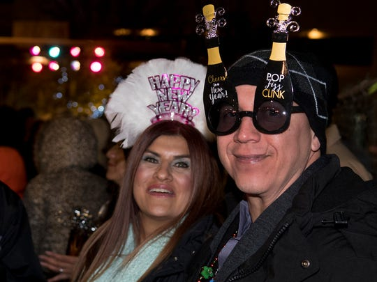 Ruben, L, and Dafney, R, Murillo drove in from El Paso to witness their first Chile Drop on Plaza de Las Cruces Sunday night. 12/31/17Gary Mook/ for the Sun-News