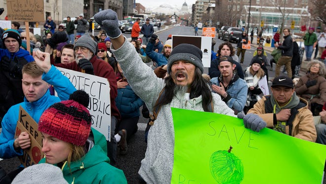 "Randall Lanza of Salt Lake City chants ""Save Our Sacred Lands"" during President Trump's national announcement to eliminate vast portions of Utah's Bears Ears and Grand Staircase-Escalante national monuments in Salt Lake City on Monday, Dec. 4, 2017."