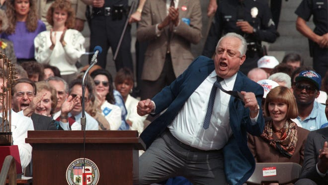 Los Angeles Dodgers manager Tommy Lasorda dances for the team's fans during celebrations of their World Series win in downtown Los Angeles, Ca., on Oct. 24, 1988.