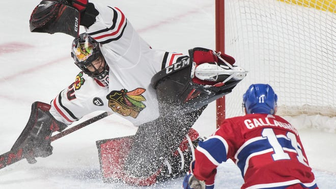 Former Chicago Blackhawks goaltender Corey Crawford stops a shot by Montreal Canadiens forward Brendan Gallagher on Saturday, March 16, 2019, in Montreal. Crawford will not be returning to the Hawks, the team announced Thursday.