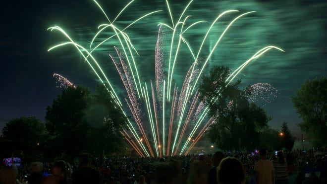 Salem area residents celebrated Independence Day with a fireworks show and music at Riverfront Park on July 4, 2015.