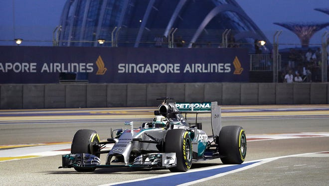 Mercedes driver Lewis Hamilton posted the fastest time during Friday's practice session for the Singapore Grand Prix.