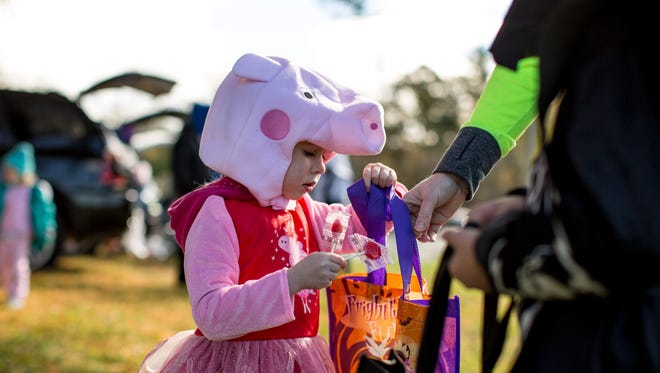 Lillian Johnson, 3, of St. Clair Township, is dressed as Peppa Pig during a trunk-or-treat Saturday, Oct. 22, 2016 at St. Clair Township Park.