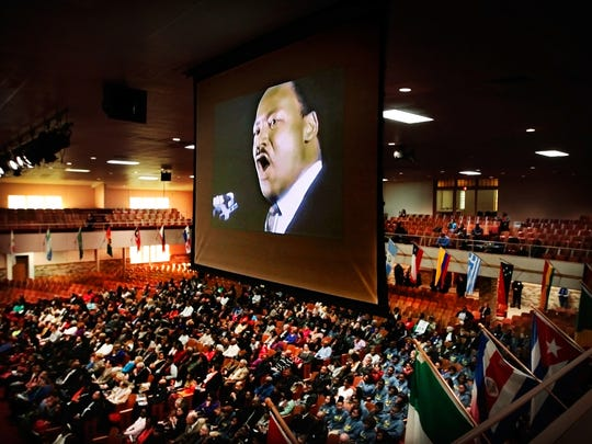 A video of Martin Luther King Jr's last speech at Mason Temple is projected over the audience gathered at the historic COGIC church during the Be the Dream Commemorative Celebration.