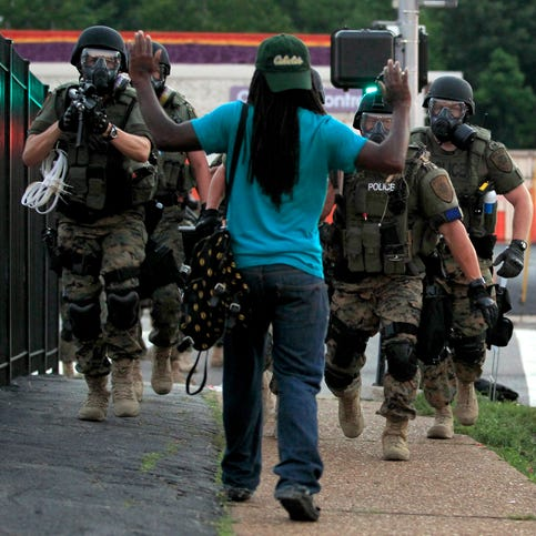 Police, protesters clash in Ferguson over teen's death