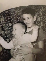 David Shaw, right, with younger brother, Kenneth, shortly before their father, Rochester Police Officer Harold Shaw, was killed in the line of duty in December 1959.
