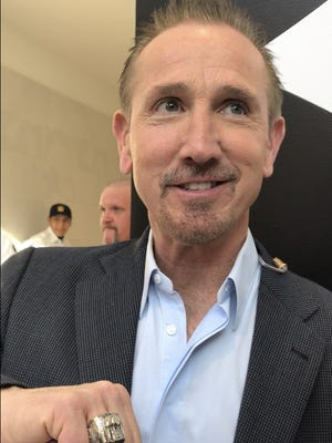 Former Giants defensive coordinator and interim head coach Steve Spagnuolo shows off his ring from Super Bowl XLII while speaking at the Mall of America during festivities leading up to Super Bowl LII in Minnesota.