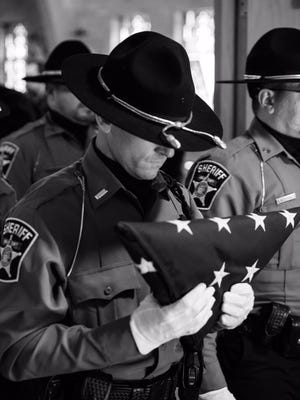 Members of numerous law enforcement agencies paid tribute to Sgt. Thomas Connelly, an officer with the Langland County Sheriff's Department, who died on Oct. 1.