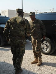"Col. Issac ""Ike"" Gipson, foreground, commander of the 11th Air Defense Artillery Brigade, receives Lt. Gen. Michael Garrett, commander of Army Central Command, outside of brigade headquarters in November."