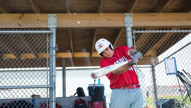 Incarnate Word Academy's Robert Walsh warms up between innings during a game at Veterans Memorial High School on Thursday, March 1, 2018.