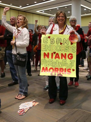 An Iowa State fan holds up a sign about Iowa State players Georges Niang and Monte Morris during the Fan Tipoff Spirit Rally hosted by the Iowa State University Alumni association before Iowa State's appearance in the Big 12 Men's Basketball Tournament on Thursday, March 10, 2016, in Kansas City.