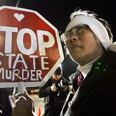In this Dec. 12, 2005, file photo, Barbara Chan protests