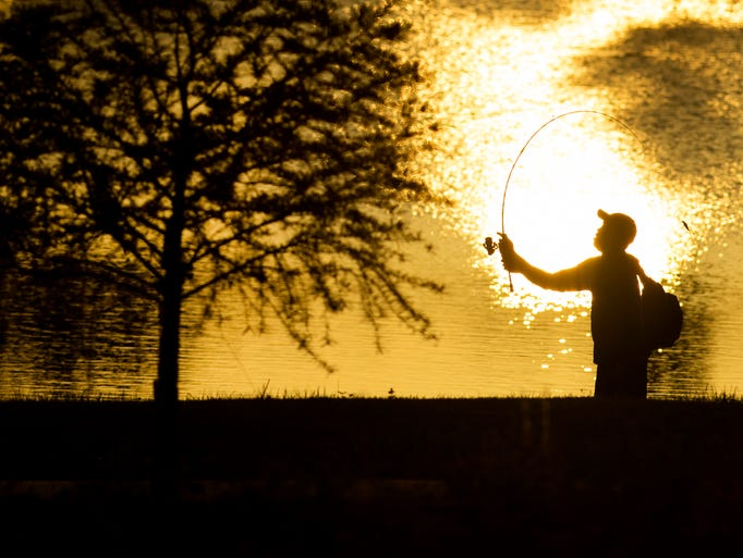 Cecil Rouse of Newburgh, Ind., casts at Friedman Park's