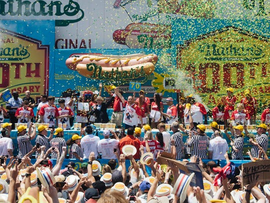Joey Chestnut (center) wins the Nathan's Famous Fourth