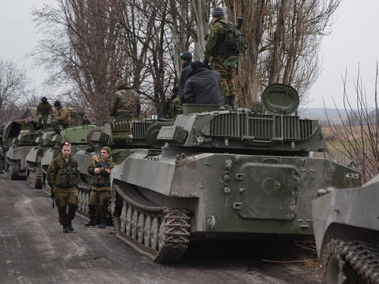 Russia-backed separatist fighters stand next to self