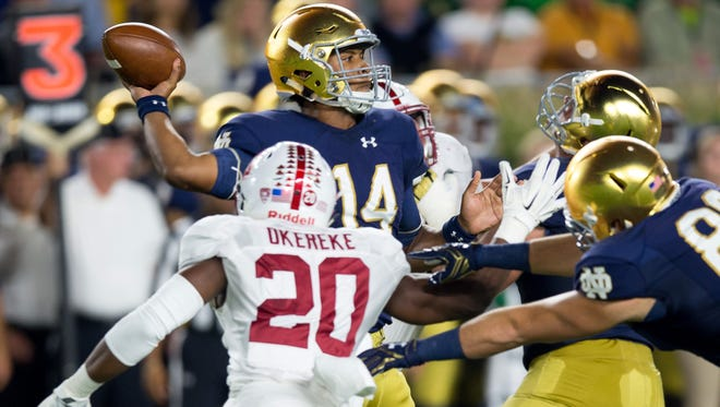 Oct 15, 2016; South Bend, IN, USA; Notre Dame Fighting Irish quarterback DeShone Kizer (14) throws as Stanford Cardinal linebacker Bobby Okereke (20) pressures in the first quarter at Notre Dame Stadium. Mandatory Credit: Matt Cashore-USA TODAY Sports