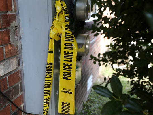Police tape can still be seen next to the Cypress Drive