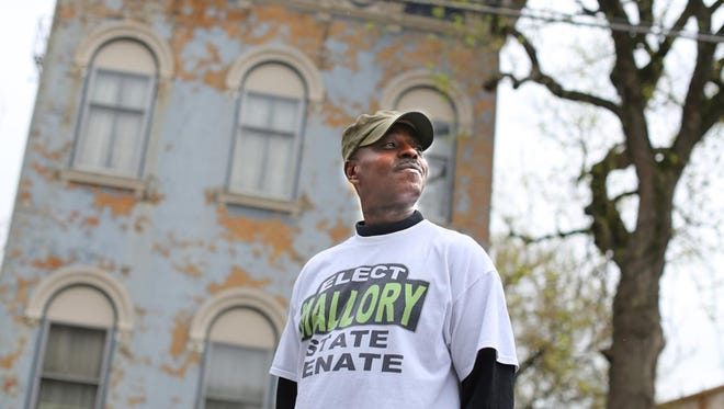 Ohio state Rep. Dale Mallory stands in front of his home on Dayton Street in West End. Mallory is term limited as representative and is running for a state Senate seat.