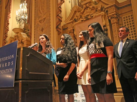 Megan McCormick (left) speaks with classmates Santoshi Kandula, Rhea Rawal and Tejasvini Dantuluri at the Jefferson Awards Foundation Salute to Service ceremony Monday at the Hotel du Pont in Wilmington. They received the Outstanding Service award.