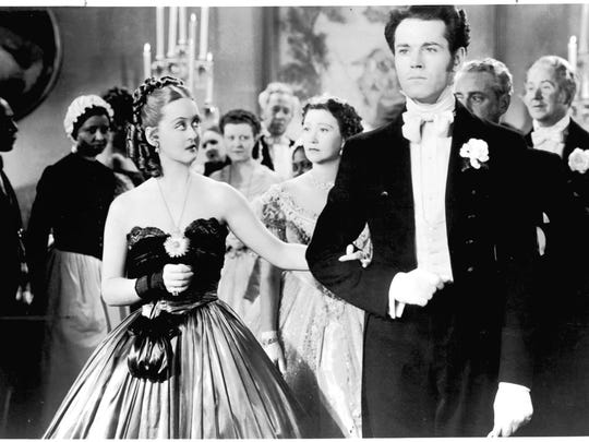 Bette Davis, left, and Henry Fonda appear in a scene