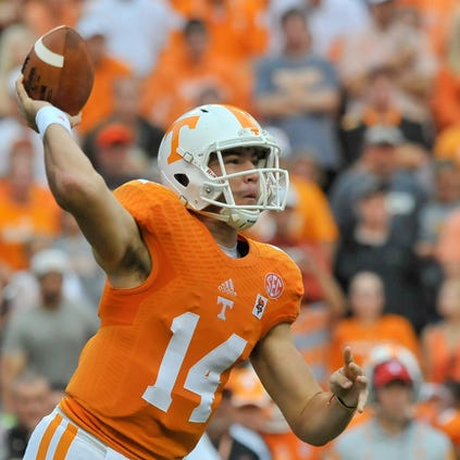Aug 31, 2014; Knoxville, TN, USA; Tennessee Volunteers quarterback Justin Worley (14) passes against the Utah State Aggies during the first half  at Neyland Stadium. Mandatory Credit: Jim Brown-USA TODAY Sports