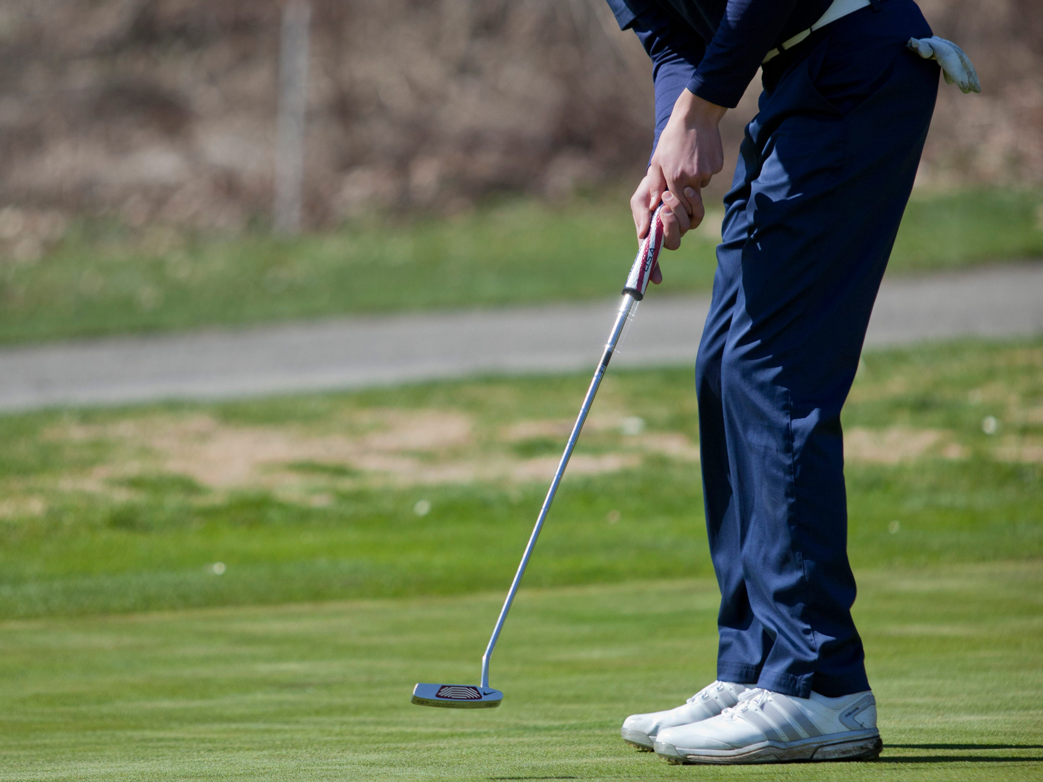Marysville junior Nick Lozano, 16, takes a putt Friday, April 17, 2015 at the Port Huron Elks Golf Club in Port Huron Township.