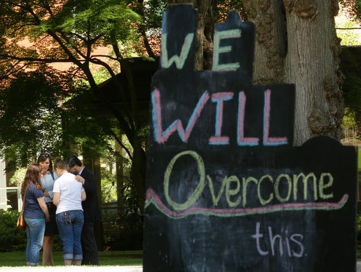 We Will Overcome This sign