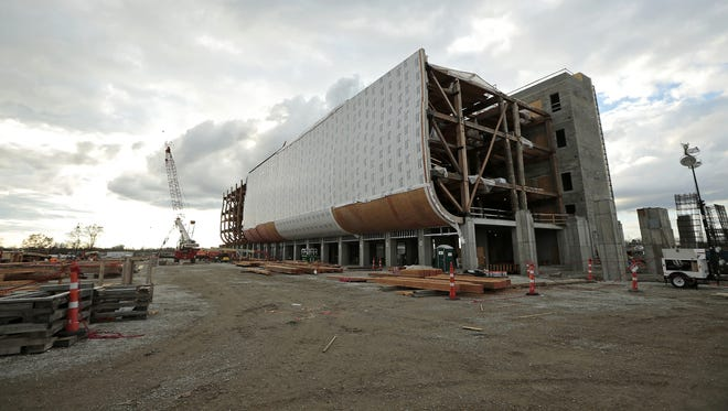 Construction continues on a scale model of Noah's Ark at the Ark Encounter attraction in Williamstown, Ky. The Ark Encounter is currently working toward raising $24.5 million to fund the project and expects to attract more than 1 million guests per year. Regular admission tickets are planned to cost $40 each. Once finished, the Ark replica will be the largest timber-framed structure in the country.