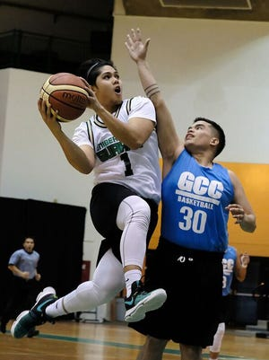 The University of Guam's AJ Carlos score on Guam Community College in the first Guam Men's College Basketball League in January of 2017. Carlos has signed top play for the Tritons in for 2018-2019.