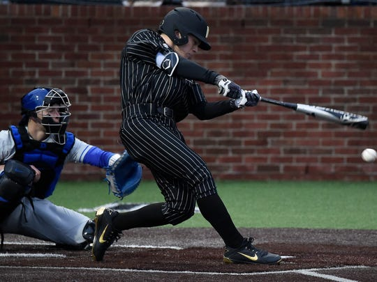 Vanderbilt catcher Philip Clarke (5) hits the ball during the game against Duke at Hawkins Field Friday, Feb. 16, 2018 in Nashville, Tenn.