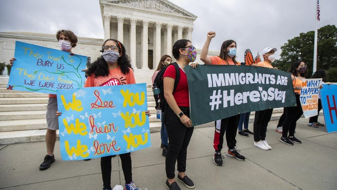 Deferred Action for Childhood Arrivals (DACA) students celebrate in front of the U.S. Supreme Court on Thursday in Washington after the Supreme Court rejected President Donald Trump's bid to end legal protections for young immigrants.