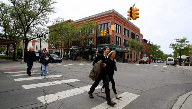 Afternoon in downtown Ann Arbor brings out the lunch crowd as seen on Thursday, May 21, 2015. The area has seen a boom with apartments, lofts and businesses. Google is moving toward North Campus at the University of Michigan because there is little room to expand.