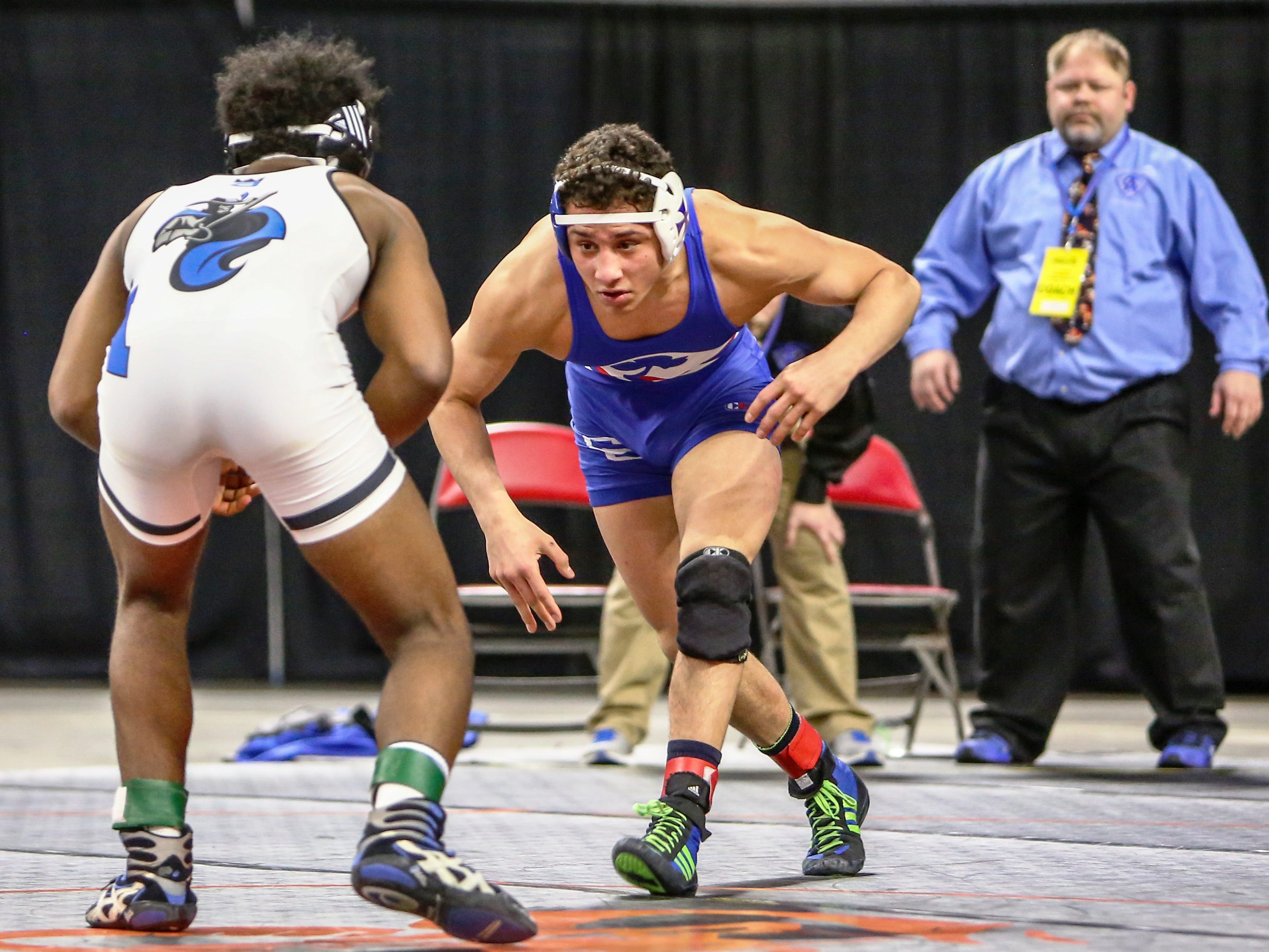 Catholic Central's undefeated 160-pounder Myles Amine (right) was named wrestling All-Area Player of the Year.