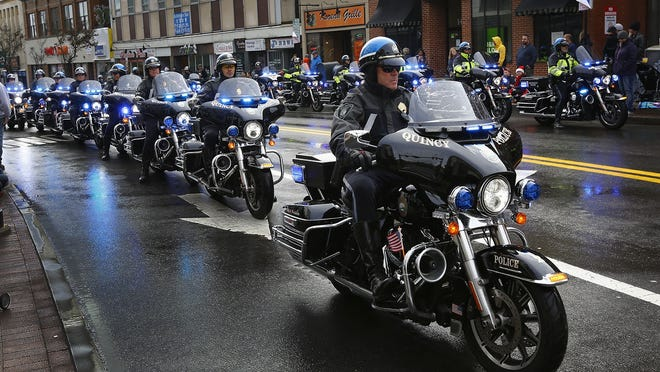 Members of the Quincy police motorcycle unit clear the parade route on Sunday, Nov.25, 2018 Greg Derr/ The Patriot Ledger