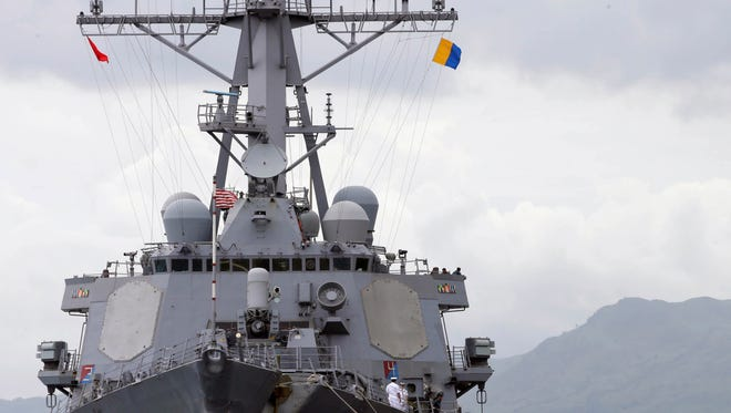 The U.S. Navy warship USS John McCain, an Arleigh-Burke class destroyer, is docked at the Subic Freeport to take part in the joint US-Philippines naval exercise called Cooperation Afloat Readiness And Training (CARAT) at the former US naval base of Subic, about 70 miles west of Manila, Philippines. After more than a decade of helping fight al-Qaida-linked militants, the United States is disbanding an anti-terror contingent of hundreds of elite American troops in the southern Philippines where armed groups such as the Abu Sayyaf have largely been crippled, officials said Thursday.