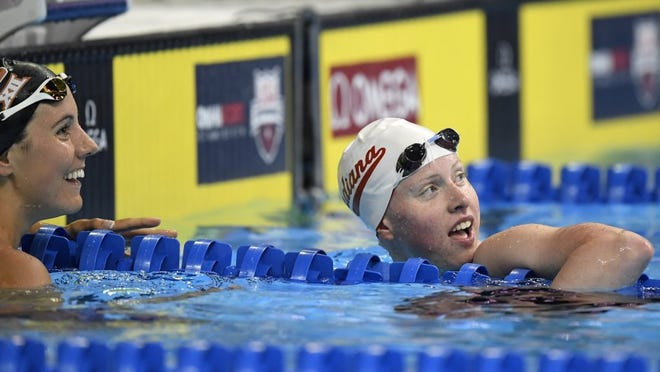 Laura Sogar, left, talks with Lilly King after their heat in the women's 200-meter breaststroke preliminaries at the U.S. Olympic swimming trials, Thursday, June 30, 2016, in Omaha, Neb. (AP Photo/Mark J. Terrill)