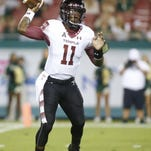 Temple quarterback P.J. Walker (11) throws to a receiver during the first quarter of an NCAA college football game against South Florida on Saturday, Nov. 14, 2015, in Tampa, Fla. (AP Photo/Brian Blanco)