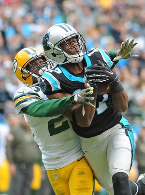 Carolina Panthers wide receiver Devin Funchess (17) catches a deep pass against Green Bay Packers cornerback Damarious Randall (23) at Bank of America Stadium in Charlotte, N.C.