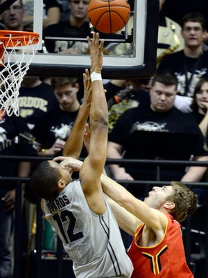 Jan 10, 2015; West Lafayette, IN, USA; Purdue Boilermakers forward Vince Edwards (12) attempts to block a shot from Maryland Terrapins guard/forward Jake Layman (10) during the second half of the game at Mackey Arena. the Maryland Terrapins beat the Purdue Boilermakers 69 to 60. Mandatory Credit: Marc Lebryk-USA TODAY Sports
