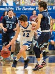 Decatur's Brett Berquist (22) moves the ball during