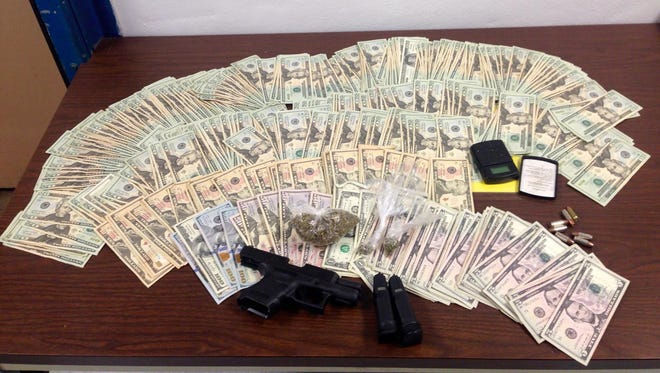 Greenville police seized more than $8,000 and 33 grams of marijuana during a traffic stop.