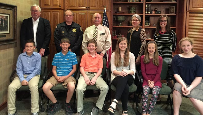 Each year the Mountain Home Kiwanis Club sponsors Student Government Day. Students elect their officials who spend a day with their counterpart. Here are this year's county officials, front row, from left, Connor Strack (Assessor), Alex Arp (Sheriff), Will Beckham (County Judge),  Kathryn Dunn (County Treasurer), Tatum Smith (County Collector) and Emma Norris (County Clerk). Second row, Sam Foster (Assessor's office), Capt. Jeff Lewis (Baxter County Sheriff's office), Baxter County Judge Mickey Pendegrass, Baxter County Treasurer Jenay Mize and Baxter Circuit and County Clerk Canda Reese.