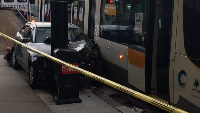 The collision between a streetcar and a car happened around 7 p.m. Monday.
