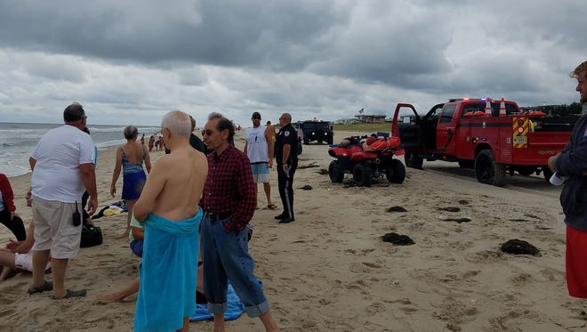 Emergency responders from cross Long Beach Island help pull three swimmers to shore.