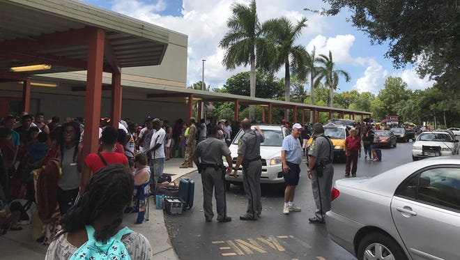 Hundreds wait outside Lely High School on Friday afternoon, trying to enter the evacuation center before Hurricane Irma arrives this weekend.