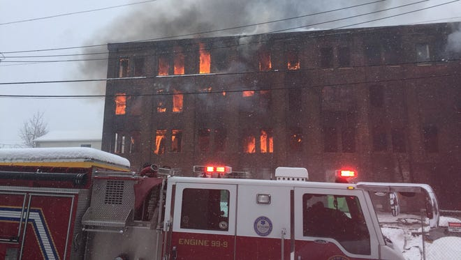 Fire can be seen in various spots in the Weaver Organ building in York.