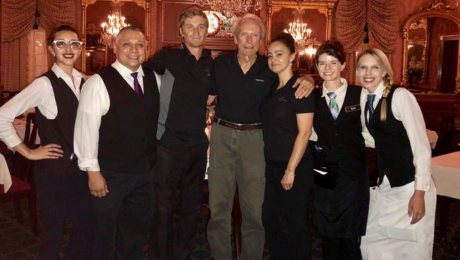 """Actor and filmmaker Clint Eastwood stands with staff from the Double Eagle Restaurant in Mesilla during the filming of his new film, """"The Mule,"""" in July."""