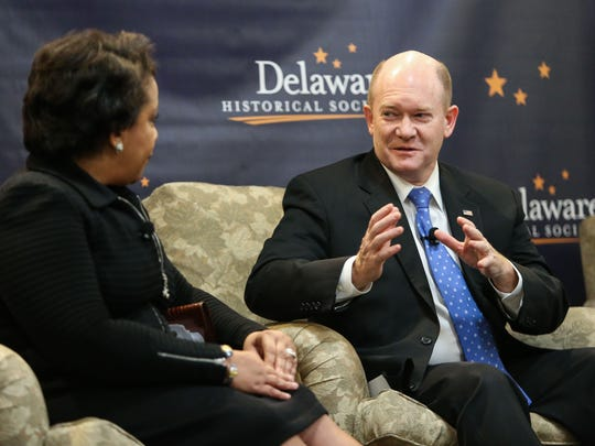 United States Attorney General Loretta Lynch speaks with Senator Chris Coons during a community discussion Monday at the Delaware Historical Society in Wilmington focused on juvenile justice.